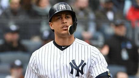 Yankees rightfielder Giancarlo Stanton looks on after he