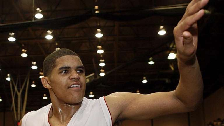 Hills West's Tobias Harris (12) accepts congratulations from