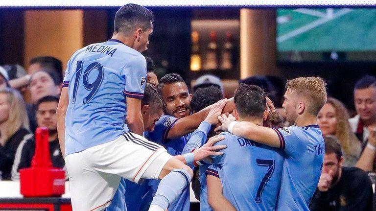 New York City FC players mob midfielder Alexander