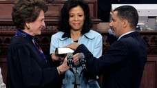 Gov. David Paterson, right, is sworn in by