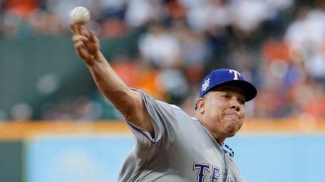 Texas Rangers' starting pitcher Bartolo Colon throws against