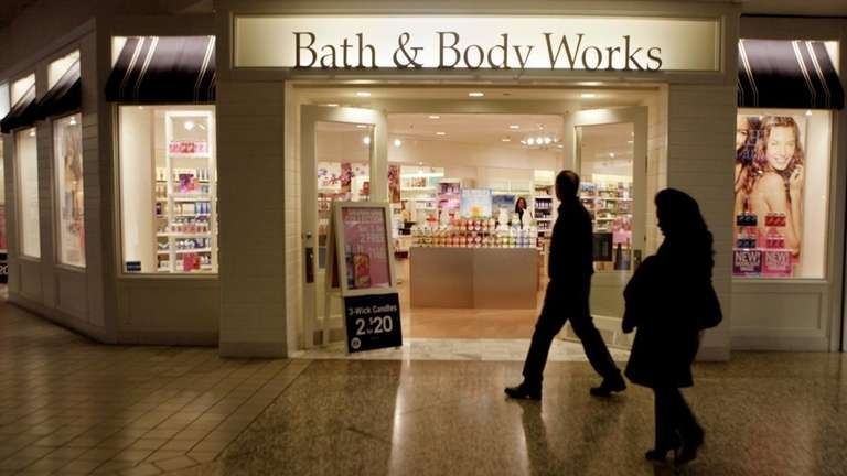 People walk by a Bath and Body Works