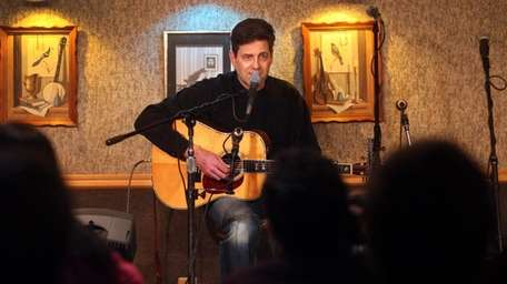 Local songwriter Arlon Bennett performs at the home