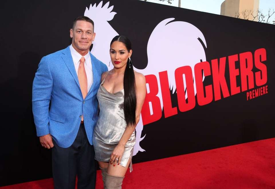 Professional wrestlers John Cena and Nikki Bella are