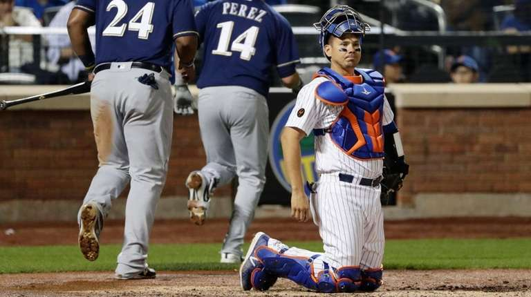 Mets catcher Jose Lobaton, right, reacts as the