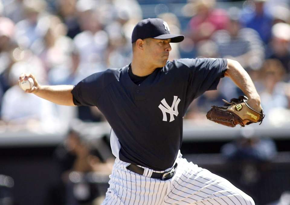 New York Yankees pitcher Javier Vazquez (31) delivers
