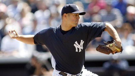 New York Yankees pitcher Javier Vazquez (31) delivers