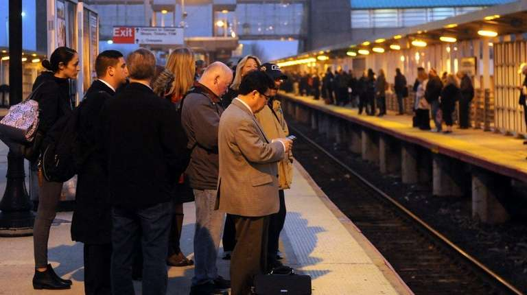 Commuters wait at the Long Island Rail Road's