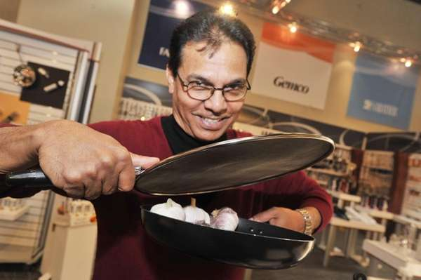 Inventor Thaddeus Alemao of Oceanside, NY demonstrates the