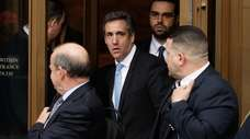 President Donald Trump's personal attorney Michael Cohen leaves