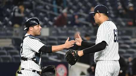 Yankees relief pitcher Dellin Betances and Yankees catcher