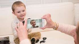 Holly Rosado films her son, Dylan, 3, unboxing