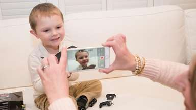 Holly Rosado films her son, Dylan, 3, unboxing