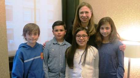 Author Chelsea Clinton with Kidsday reporters from left,