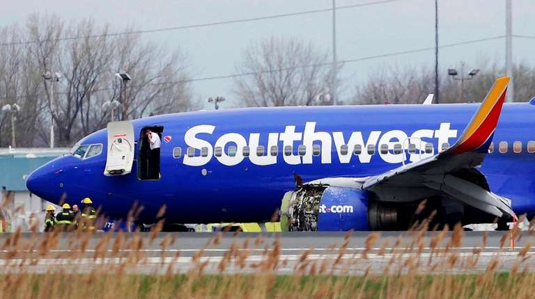A damaged Southwest Airlines plane sits on the