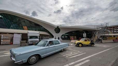 Vintage cars sit outside of the newly renovated