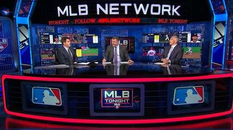 MLB Network host Brian Kenny (left) speaks with