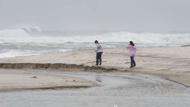Visitors watch the surf at Jones Beach after