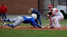 Hauppauge's Ryan Levenberg (10) dives back to first