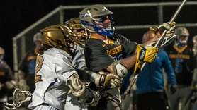 Comsewogue defenseman Zach Gagon takes the shot and