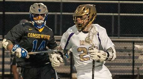 Comsewogue's Richie Lacalandra, left, runs with Islip's Mike
