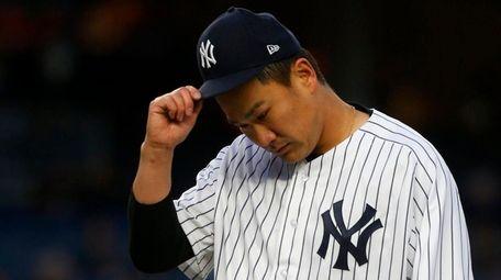 Masahiro Tanaka of the Yankees reacts during a