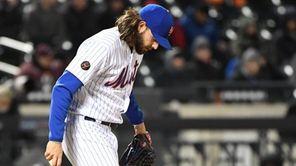 Mets relief pitcher Robert Gsellman kicks the mound