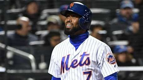 Mets pinch hitter Jose Reyes reacts after he