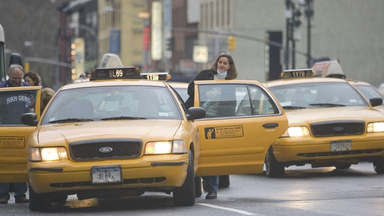 Passengers enter taxis on 8th Ave between 34th