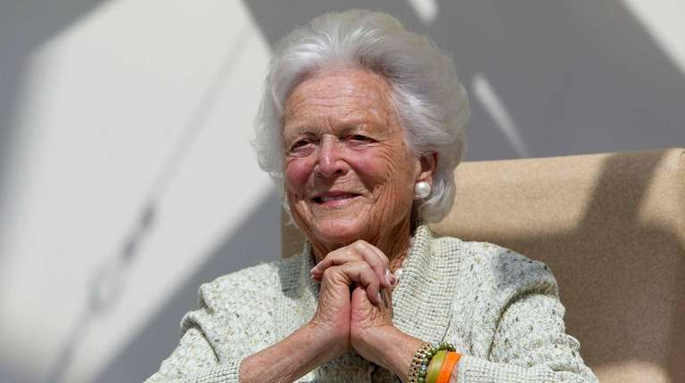 Former first lady Barbara Bush listens to a