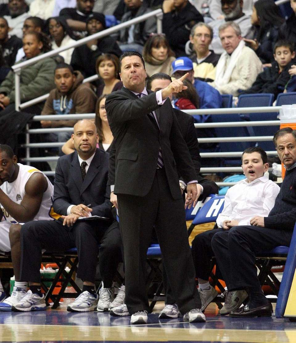 Hofstra head coach Tom Pecora gives signals from
