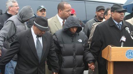 Erica Boynton, center, whose son Christopher died last