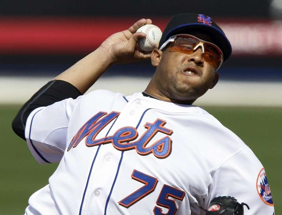 Mets pitcher Francisco Rodriguez throws in relief in