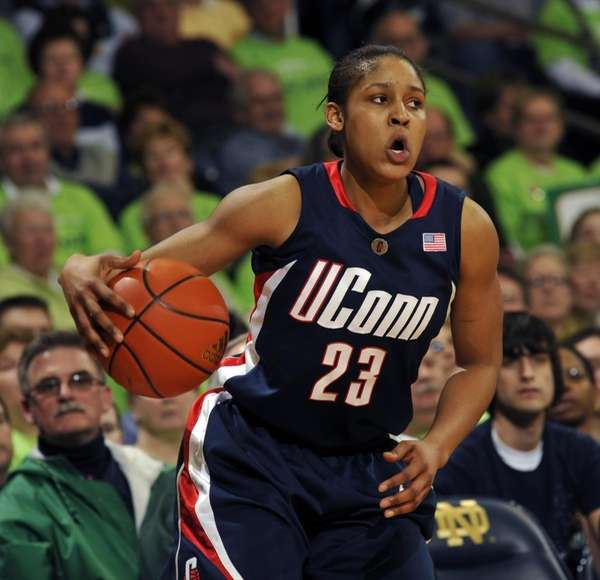 Connecticut guard Maya Moore heads upcourt in the