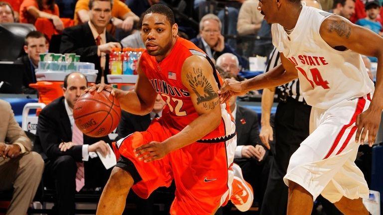 Illinois guard Demetri McCamey drives with the ball