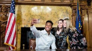Former Penn State running back Saquon Barkley poses