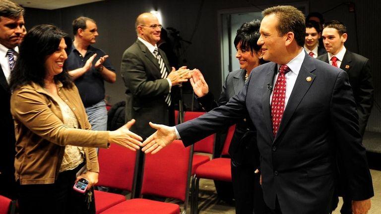 Nassau County Executive Edward Mangano, right, shakes hands