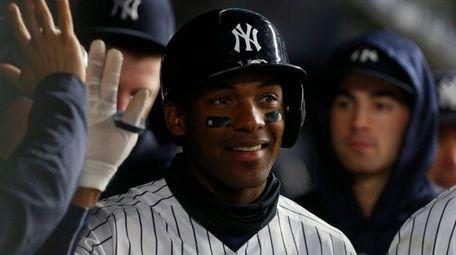 Yankees third baseman Miguel Andujar celebrates a home