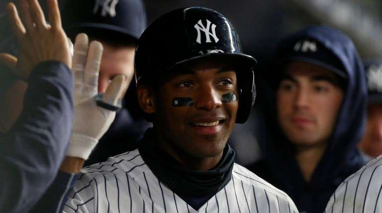 Yankees third baseman Miguel Andujar celebrates a home