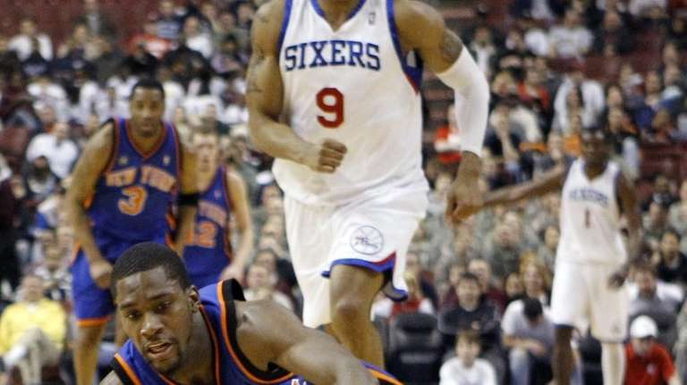The Knicks' Toney Douglas dives for a loose