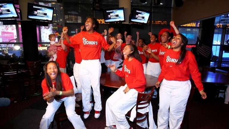 The St. John's women's basketball team reacts to