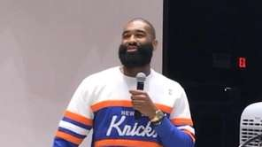 Knicks center/forward Kyle O'Quinn speaks to students at