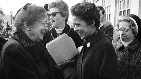 Milwaukee alderman Vel Phillips, right, is greeted as