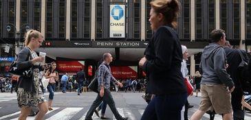 Pedestrians walk near Penn Station.