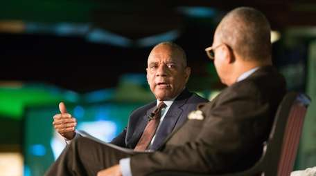 Kenneth Chenault, left, chairman and managing director at