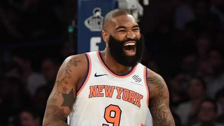 New York Knicks center Kyle O'Quinn reacts after