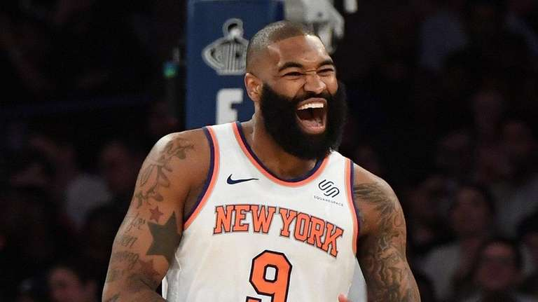 New York Knicks center Kyle O'Quinn reacts after