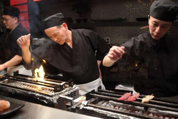 Yakitori chefs watch the grill at Two Steak