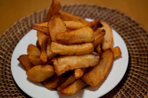 French fries lie on a plate at Deli
