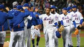 Mets players including leftfielder Yoenis Cespedes, center, celebrate